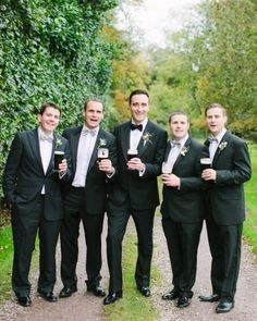 Dapper groomsmen posed with a pint of Guinness for this wedding in Ireland   Photography: @Katie Stoops