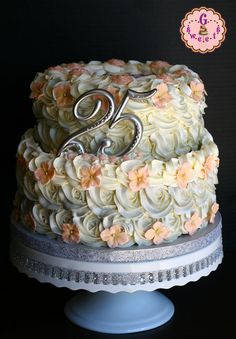 Silver Wedding Anniversary Cake....like the flowers on top of the rose swirls......