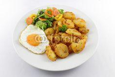 Potatoes with egg and salad
