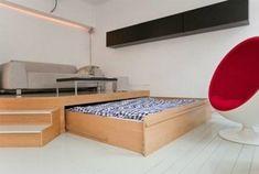 Vardagsrum och sovrum i ett rum
