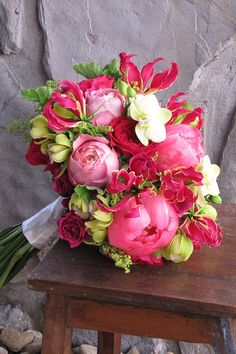 Bouquet with gloriosa lilies, Coral Charm peonies, Darcey and Romantic Antike garden roses, green cymbidium and Phalaenopsis orchids, alchemilla and scented geranium. By Floral Verde in Cincinnati