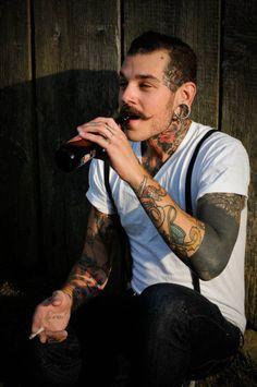 Greaser..... Nice tattoos!