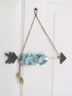 Floral Arrow // Hanging Floral Arrow // Nursery Decor by VanagueliteCouture on Etsy