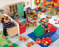 changing table facing the room, bright toys, neutral shelving, soft areas