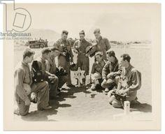 5th Marine Division Photographers at the grave of PFC Don Fox, USMCR, Iwo Jima, 1945