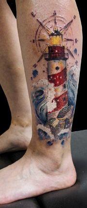Морской маяк - тату на голени парня