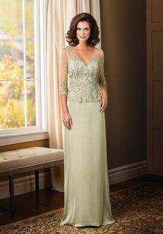 Jade Couture. This extravagant gown is a great option for your next special occasion. This dress features a classic silhouette of a V-neckline and an A-line skirt. The beading and lace detail on the bodice of this dress sets it apart from the rest.