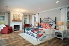 Joanna took a plain, ordinary bedroom and reimagined it with lots of color, light and decorative touches drawing on cottage style.