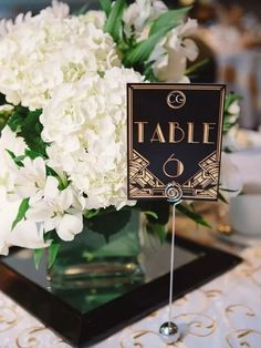 gold and black vintage great gatsby wedding table number ideas