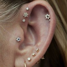 Question: Does anybody know where I can purchase an earstud like the ones which look like a little flower? I especially love the one on the left above. I can't find something similar anywhere. Thanks in advance :)