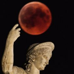 A picture shows the full moon during a 'blood moon' eclipse beside a statue of ancient Greek god Ares in central Athens on July 2018 Red Moon Eclipse, Blood Red Moon, Collage Art Mixed Media, Southern Gothic, Beautiful Moon, Space And Astronomy, Greek Gods, Out Of This World, Ancient Civilizations
