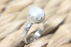 Vintage Style Pearl Engagement Ring minus the silver around the pearl. Love the band!