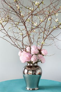 A tangle of quince is anchored with some frothy pink peonies.