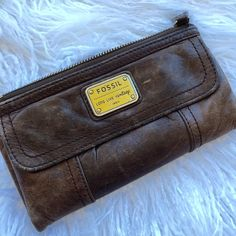 Fossil Long Live Vintage brown leather wallet Ugh this wallet is just so cool with the distressed soft leather! Has enough room for all of your cards cash and coins!  Fossil Bags Wallets