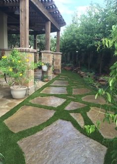 Imagine walking into your outdoor living space on this gorgeous flagstone and artificial grass walkway by Southwest Greens of San Antonio.