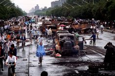 "CHINA. Beijing. June 5, 1989. Beijing citizens survey the damage on the day after the massacre. ""You see on people's faces a very discreet curiosity—they are trying to figure out what had just happened the previous night,"" says Turnley. Citizens who had been open and friendly were now afraid. Photograph: Peter Turnley/Corbis"