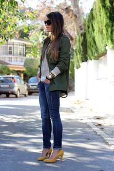 Green army jacket with skinny jeans and yellow pumps. Desire Denim.