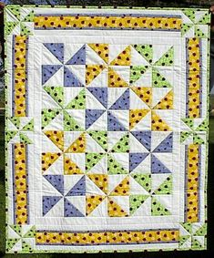 Love this happy little quilt for my grandchild.