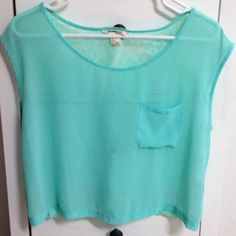 Teal summery top Short sleeve teal top with small front pocket.  The entire back is an awesome sheer pattern  worn a handful of times but still in great condition! Forever 21 Tops