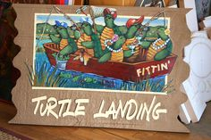 Custom residential,house sign with illustration of turtles by THE SIGN MAN of North Myrtle Beach, South Carolina.  Facebook page Residential Signs by The Sign Man.  email: wodinart@aol.com.  phone: 843-272-3820.