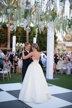 Couple on Dance Floor beneath Canopy of Draping Wisteria Vines | Photography: Stephanie Fay Photography. Read More: http://www.insideweddings.com/weddings/sophisticated-garden-inspired-wedding-in-phoenix-arizona/659/