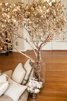 Gold painted tree branches.