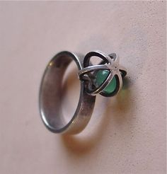 "Sterling Silver Scandinavian modernist ""caged"" green onyx ring by Elis Kauppi for Kupittaan Kulta, Finland"