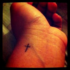 Tiny cross tattoo- love the placement for a wrist tattoo Cross Tattoo On Wrist, Simple Cross Tattoo, Small Tattoos, Cool Tattoos, Tatoos, Wrist Tattoos, Mini Tattoos, Awesome Tattoos, Piercings