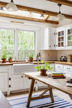 Love this kitchen. White cabinets with wood counter tops. Farmhouse sink. Big…