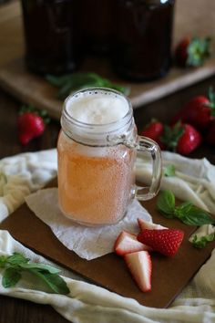 Kombucha is a naturally-fermented probiotic drink filled with health benefits. Make a Strawberry Basil flavor at home! Drinking kombucha every day is a habit I picked up while I was writing my coo Kombucha Fermentation, How To Brew Kombucha, Kombucha Tea, Fermentation Recipes, Kombucha Flavors, Probiotic Drinks, Yummy Drinks, Healthy Drinks, Healthy Snacks