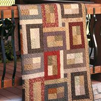 Patchwork Fields is a fat quarter friendly quilt that adds a rustic, country charm to home decor.