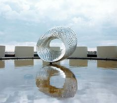 Mobius strip, designed by Dr Robert Wilson, first director of Fermilab, Illonois, USA. He believed scientists should work in places of great art and beauty. Cheers to that! The sculpture is in a pool atop Ramsey Auditorium. It is built of 3 x 5 inch pieces of stainless steel which were welded on a tubular form eight feet in diameter.