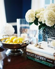 Tablescape Photo - A footed bowl of lemons and a blue-and-white vase of flowers on a wooden tabletop