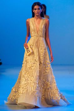 Gorgeous -- gold, plunging v-neck plisse gown. Loving the less delicate vertical embroidery along with the floral embellishment. Elie Saab. #spring2014 #couture #eliesaab