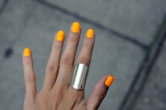 bright orange nails + silver cuff.