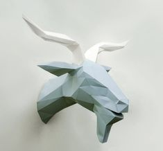 Excellent polygonal head of the goat may soon zyavytys in your home! Stylish and original, this goat will be wonderful additions to your interior. Just choose the color!  The set comes pre-cut and perforated pieces of thick paper (160 g / m). You just bend facets and glue them correctly. It saves you a lot of time, because more than half of the work we have done to you is the most enjoyable part)  All you need is a few hours of your time and maximum accuracy. Also ask your friends to hel...