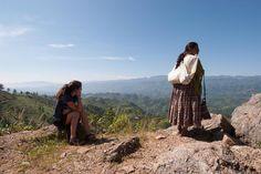 A tourist an a local take in the view in Guatemala. #everdaylatinamerica #picoftheday #tourism #photojournalism #guatemala #guatemaya #mayan #maya #documentaryphotography #streetphoto #streetphotography #socialdocumentaryphotography #sociallandscape #photooftheday #color #globalization by johngallagherphotography