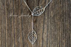 Leaf Lariat Silver Necklace by ReinaJewelry on Etsy, $23.00  Lovet this - just bought one!