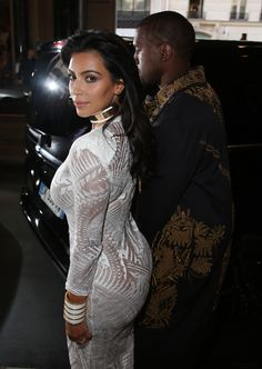 Kim and Kanye arriving at the Balmain Spring/Summer 2015 Fashion Show in Paris, France