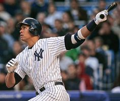 New York Yankees' Alex Rodriguez swings for a three-run home run during the first inning against the Los Angeles Angels on April 26, 2005, at Yankee Stadium in New York. Rodriguez later hit a two run homer during the third inning and a grand slam during the fourth inning. (Julie Jacobson/AP)