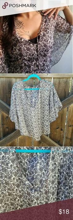 Butterfly sleeve flowy blouse Filigree detailed blouse with butterfly sleeves. Lightweight for summer, perfect color for fall and winter! 100% Polyester.  Make an offer. Robin K. Tops Blouses
