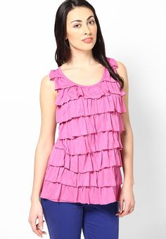 Pink Solid Ruffle Top @ $45.60 (24% OFF) https://www.dollyfashions.com/tshirt-company-pink-solid-ruffle-top-3000442512.html