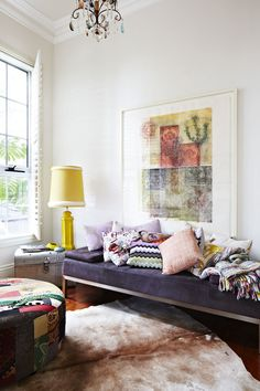 Daybed, pillows, amazing artwork, groovy lamp... and a chandelier to top it all off.  Love, love, love!