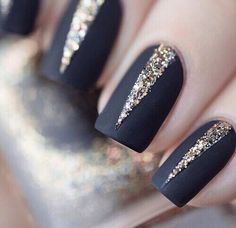 Black matte nails with glitter gold accents