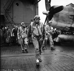 Navy Hellcat pilots cross the flight deck of the USS Saratoga and head for their planes just before the Japanese on Rabaul were hit a smashing blow. Miller took the images while with the military unit assigned to document the conflict