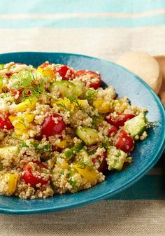 Greek Quinoa Salad — This Greek quinoa salad isn't just tasty it's good-looking, too, with halved cherry tomatoes, yellow peppers, and shreds of chopped fresh dill.
