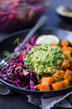Roasted Butternut Squash Burrito Bowls! You will love these gluten-free and vegan burrito bowls. Butternut squash, bean & cabbage slaw with guacamole.