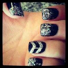 Black and silver (gel) glitter manicure with chevron on ring finger...super cute!