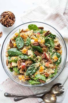 This simple fall quinoa salad combines roasted butternut squash, crispy sweet apples, toasted pecans and spinach for a hearty & delicious meal-sized salad.