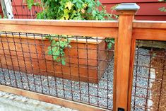 Wood and wire fence. This would be great around our garden since wild pigs are the only animal to worry about here.